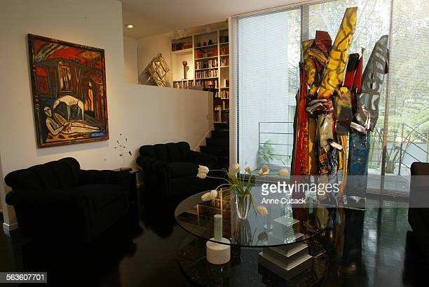 In the living room is a sculpture Cafe Macedonia by John Chamberlain and on the wall at left is City of Gypsies by Mimmo Paladino Mandy and Cliff...