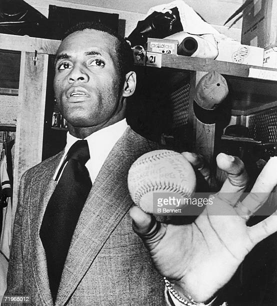 In the locker room of Three Rivers Stadium Puerto Rican baseball player Roberto Clemente of the Pittsburgh Pirates holds the 3000th ball he hit...