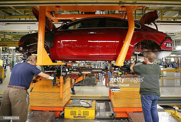 In the marriage zone the chassis and body come together from separate assembly areas Cameros are built on the assembly line at the GM Oshawa Assembly...