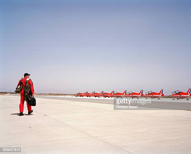 In the midday heat Squadron Leader John Green is a member of the elite 'Red Arrows' Britain's prestigious Royal Air Force aerobatic team Here he...