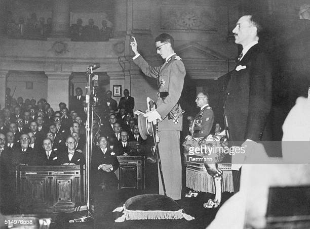 In the midst of a special session of the Belgian Parliament on August 11th, Crown Prince Baudouin, is shown as he took oath of office, becoming...