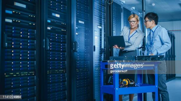 Gallo Images - 1141224984 - modern data center engineer it
