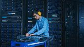 modern data center it technician wearing