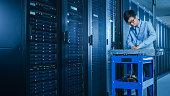 modern data center it technician working