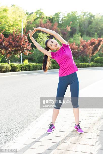 in the morning girl outdoors sport - little girls bent over stock photos and pictures