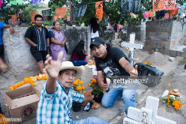 In the nahua community of San Agustin Oapan Guerrero in Mexico families went to the cementery to remember and visit their deceased loved ones...