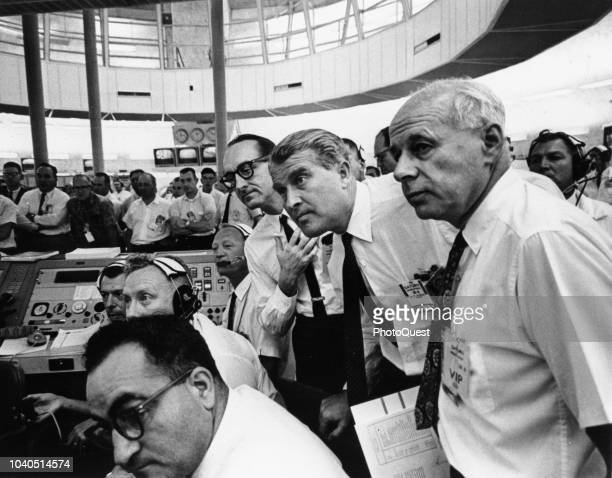 In the National Aeronautics and Space Administration control room scientists await the liftoff of a Saturn launch vehicle carrying a test spacecraft...
