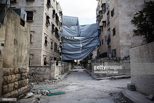 In the neighborhood of Izaa large tarps are hung in between building to limit the view of regime snipers who have been targeting FSA fighters as well...