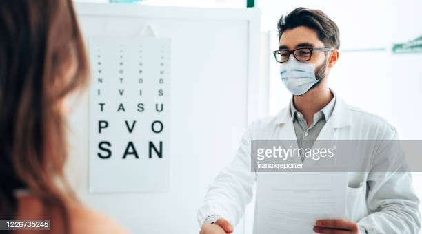in the office of the optometrist - eye doctor stock pictures, royalty-free photos & images