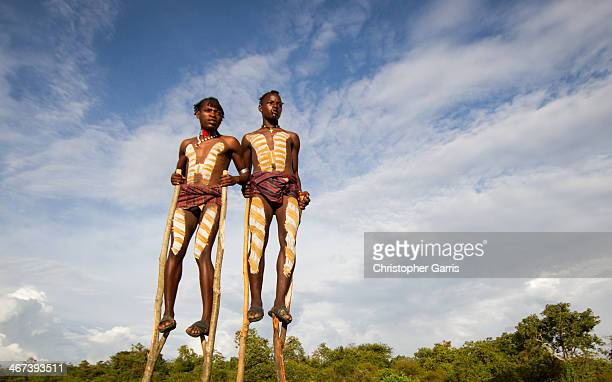 CONTENT] In the Omo Valley two young Hamar tribesmen in heavy body paint are seen walking on stilts in an effort to gain tips from tourists