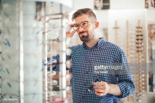 in the optics store - optometry stock pictures, royalty-free photos & images