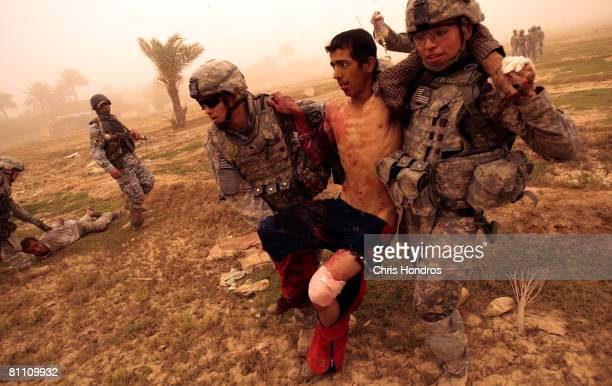 In the orange fog of an Iraqi sandstorm medic Sgt Matthew Kunkle and Private Aaron Livas of the US 2nd Battalion 30th Infantry Regiment of the 10th...