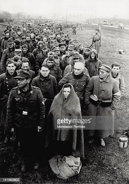 In the outermost periphery of Berlin German prisoners taken by the Allied Forces in the capital city are gathered together May 1945