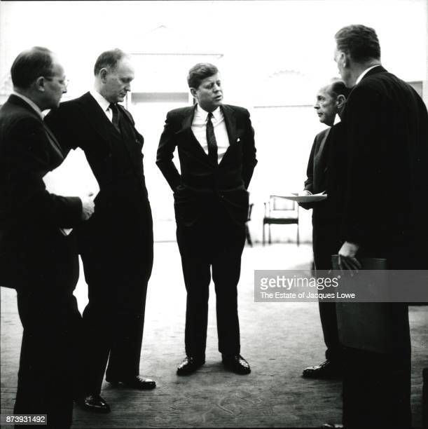 In the Oval Office US President John F Kennedy meets with Deputy National Security Advisor Walt Whitman Rostow US Secretary of the Treasury C Douglas...