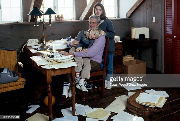 In the paper-strewn writing studio at his summer home, American writer and journalist George Plimpton poses with his children, Taylor Ames Plimpton...