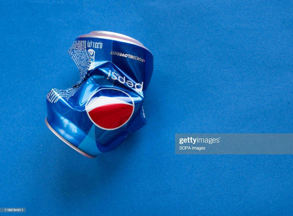 In the photo illustration a crumpled Pepsi aluminium can... : News Photo