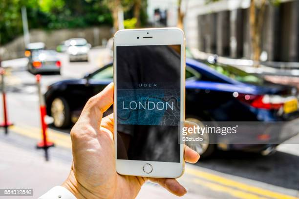 In the photo illustration a iPhone6S plus displays the logo of Uber ridehailing app and the London map app on 26 September 2017 in Hong Kong Hong...