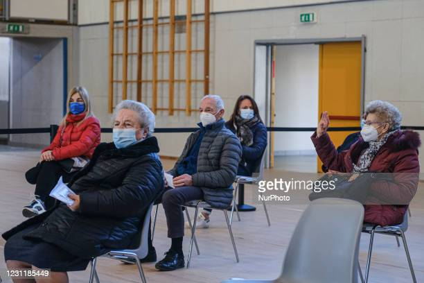 In the picture elderly over 80 waiting to receive the first dose of the vaccine against Covid19 produced by Pfizer-BioNTech. They are seated in the...
