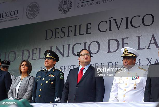 In the picture is the governor of Veracruz Javier Duarte de Ochoa accompanied by military and police authorities who are watching military and police...