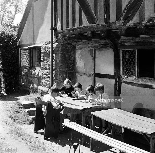 In the Pilgrims Rest the ancient Tudor looking hostelry outside the Battle Castle are 5 children having their school meal They and their school mates...
