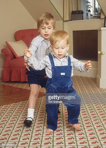 In The Playroom At Home In Kensington Palace Prince Harry Takes His First Steps Helped By His Brother Prince William