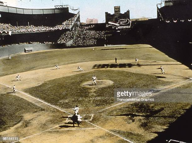 NEW YORK OCTOBER 9 1951 In the Polo Grounds in New York during game 5 of the 1951 World Series Yankee second baseman Gil McDougald has just struck a...