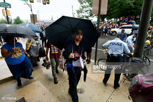 In the rain Pastor Aden Rusfeldt and the group of mostly family members packed up shortly after 2pm after protesting at the Pride Parade in...