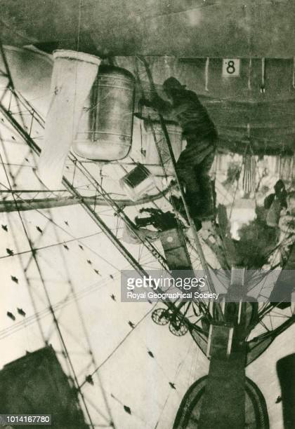 In the rigging of the Norge showing flags to be dropped at the Pole The Roald Amundsen Lincoln Ellsworth 1926 flight across the Polar Sea in the...