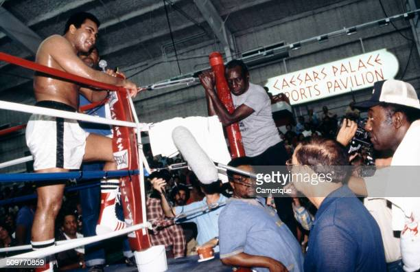 In the ring during training American heavyweight boxer Muhammad Ali speaks into a microphone Las Vegas Nevada September 1982