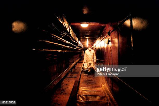 In the rooms damaged by the explosion inside the shelter, debris has been pushed aside to make passages, like this corridor which leads to the lower...