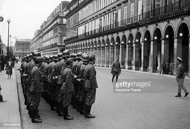 In the rue de Rivoli near the Intercontinental Hotel which the Gestapo has taken over this troop of German soldiers is inspected by an officer in the...