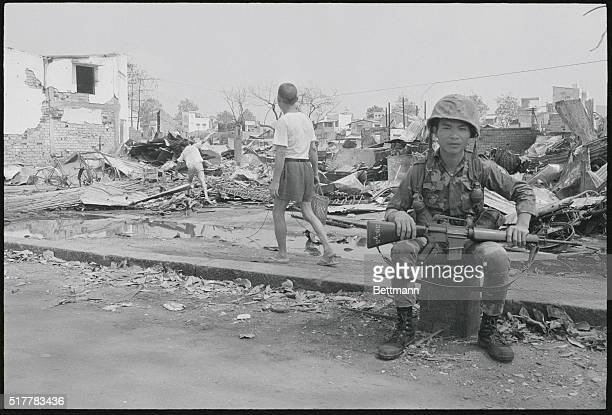 In the Ruins of Cholon Saigon A Vietnamese soldier sits near ruins of some of the buildings destroyed in recent fighting in Cholon Saigon's Chinatown...