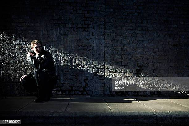 in the shadows - black alley stock photos and pictures