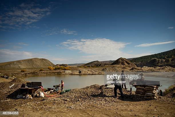 """In the Sharyngol district of Mongolia, a group of """"ninjas"""" work in underground passages to mine for gold around a lake that was created through..."""