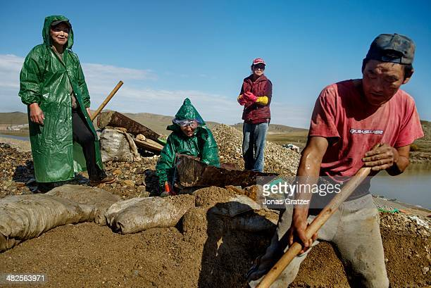 """In the Sharyngol district of Mongolia, a group of """"ninjas"""" work to pan out the soil and rocks that they dug from narrow underground passages in the..."""