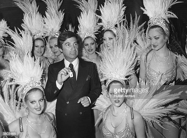 In the shining atmosphere of the Lido in Paris the Bluebell Girls award the golden tie of 1979 to the actor JeanClaude Brialy establishing him as...