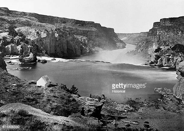 In the Shoshone Canyon in the Idaho Territory during the late 19th century, members of Clarence King's Geological Exploration of the 40th Parallel...
