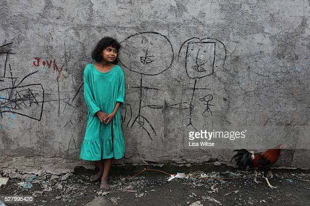 in the slums of a squatter community in the North Harbour of Manila where families work as Ulingeros or charcoal workers Many of the workers in...
