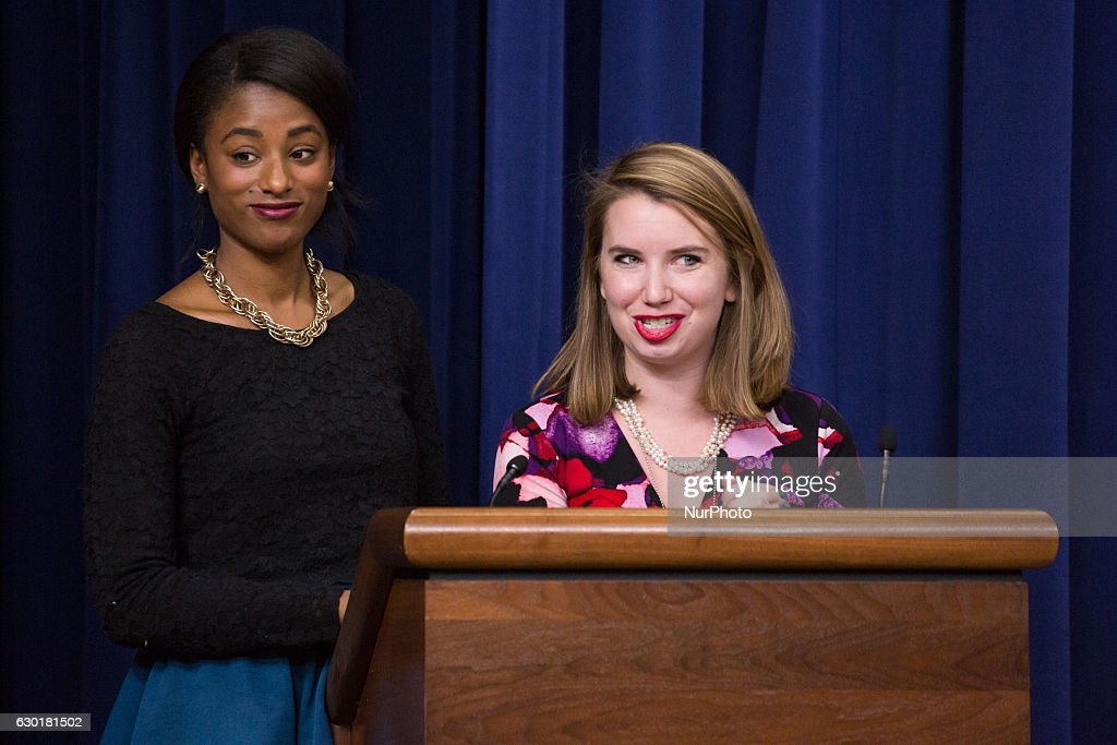 In the South Court Auditorium of the Eisenhower Executive Office Building of the White House in Washington DC, on 16 December 2016, (l-r), Kalisha Dessources, Policy Advisor to the White House Council on Women and Girls, listens, as Jordan Brooks, Deputy Executive Director of the White House Council on Women and Girls gave closing remarks at the forum: Advancing Equity for Women and Girls of Color. | ©2016 Photo by Cheriss May, www.cherissmay.com