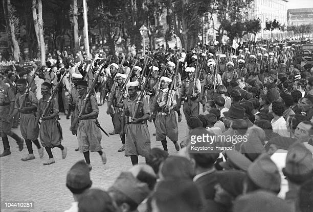 In the Spanish rebels headquarters in Burgos the crowd of insurgents cheering Moroccan 'REGULARE' who came from Ceuta and who are marching in August...