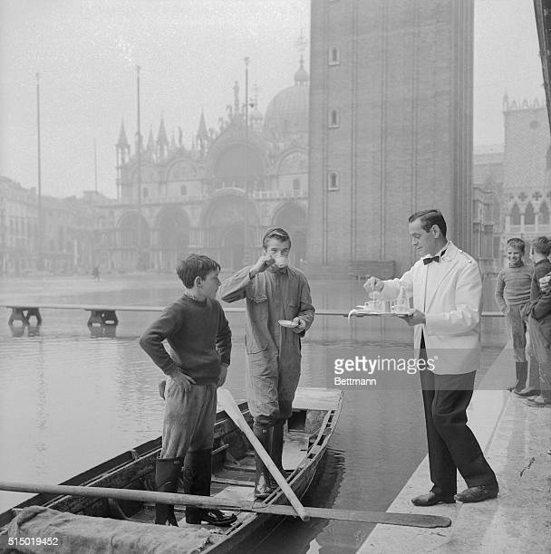 In the square noted for coffee sippers just passing the time of day a change of scene takes place with the seasonal high tides Two young Italian boys...