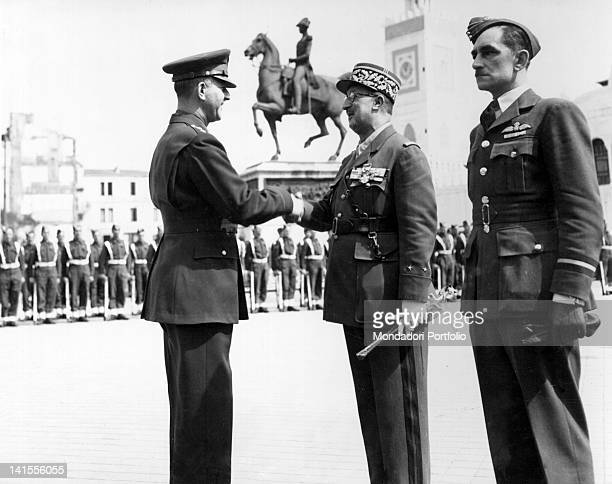 In the Square of the Government of Algiers US General Jacob Devers awarding French General Andre and a British pilot with the Legion of Merit Algiers...