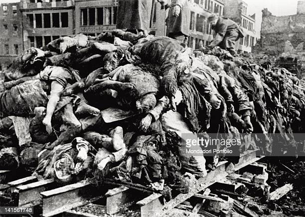 In the square of the Old Market of Dresden some soldiers heap up the victims' dead bodies of the allied raid of February 13 and 14 Dresden February...
