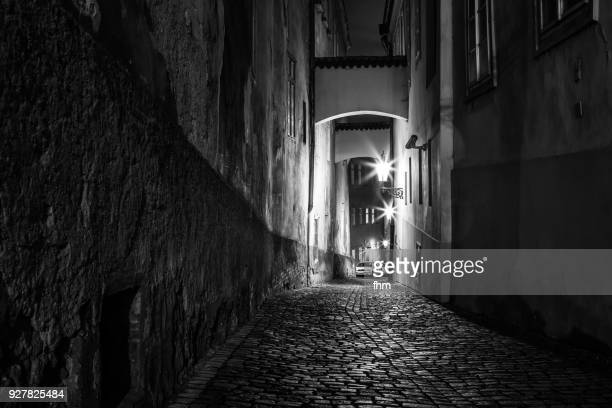 in the streets of prague at night (czech republic) - scary setting stock photos and pictures