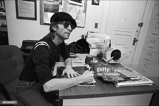 In the Studio One office he shared with his wife Yoko Ono British musician John Lennon autographs copies of the couple's 'Double Fantasy' New York...