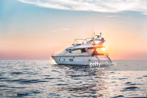 in the sunset - yacht foto e immagini stock