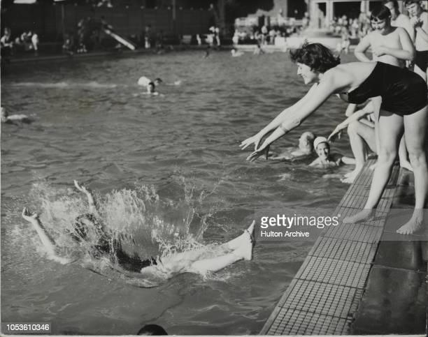 In The Swim In the swim with surprise and a splash is AUDREY CRACKNEL of Toddington a nurse at the West Middlesex Hospital helped on her way by JEAN...