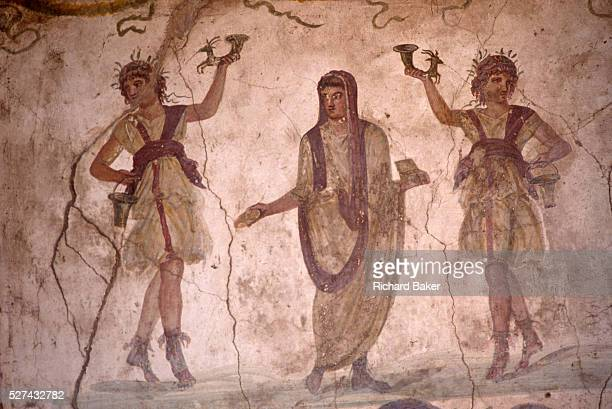 In the Villa of the Vettii in Pompeii we see a fresco in the lararium where a shrine to Roman guardian spirits of the household was situated Family...