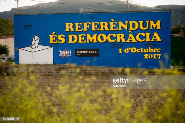 In the village of Tona Spain a mural painted on the wall of a house reading 'Referendum is Democracy' on 16 Sept 2017 Catalan goberment aims to...