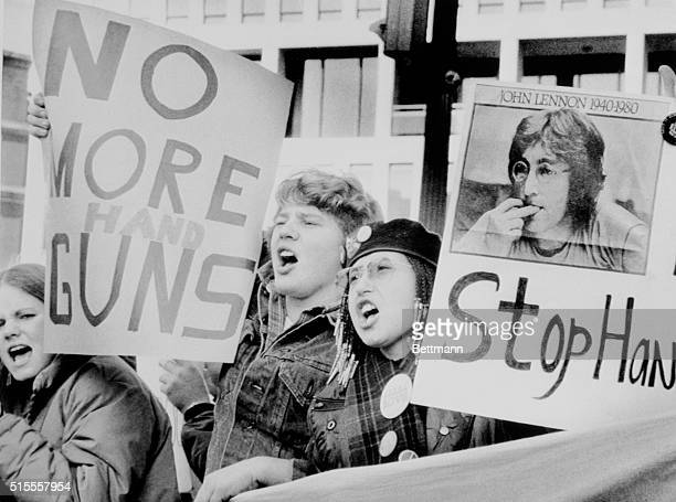 In the wake of John Lennon's death a group of protesters gather outside the National Rifle Association in an antihandgun demonstration 12/12...